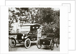 Henry Ford, American car manufacturer, with two of his cars by Anonymous