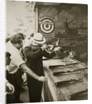 Shooting gallery at the amusement park by Anonymous
