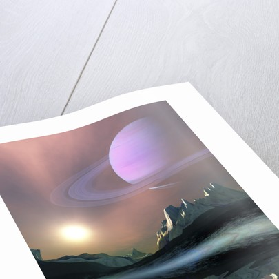 The planet Saturn lights up the sky of one of its moons called Titan. by Corey Ford