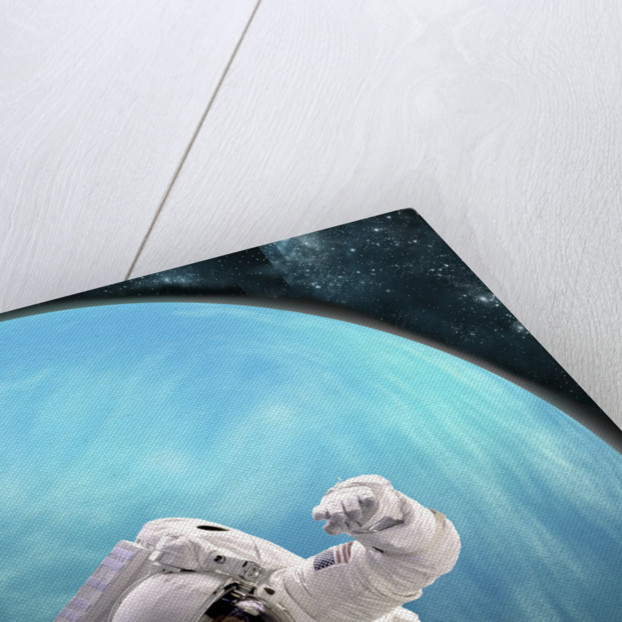 Artist's concept of an astronaut floating in outer space by a water covered planet. by Marc Ward