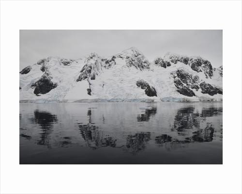 Antarctic mountains reflected in the sea, Antarctica. by Mathieu Meur