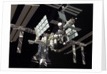 Illustration of a space shuttle is docked to the International Space Station. by Anonymous