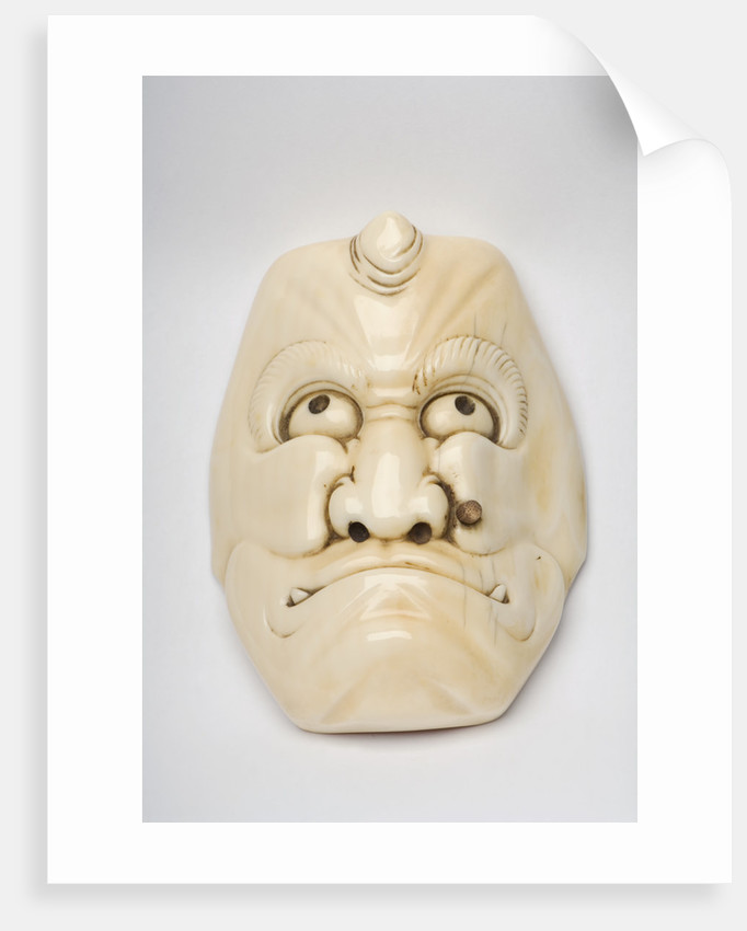 Carved ivory okimono in the shape of a face by unknown