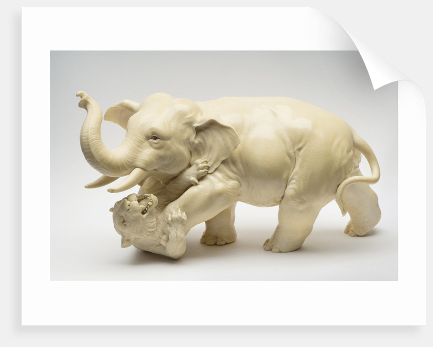 Carved ivory okimono: elephant and tiger fighting by unknown