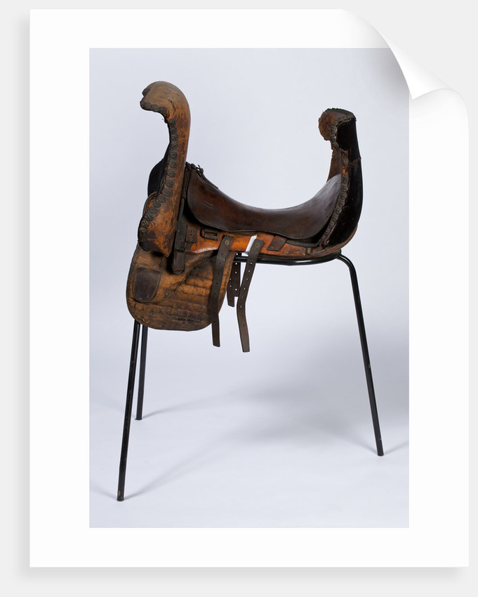 Riding saddle; also known as a Western or charro saddle by unknown