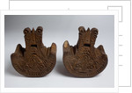 Pair of large, decoratively carved Mexican wooden stirrups by unknown