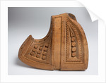 Decoratively carved wooden stirrup with an upturned toe by unknown